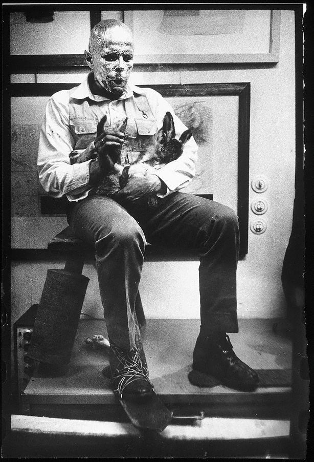 An Image Of Joseph Beuys In The Action Explaining Pictures To A Dead Hare