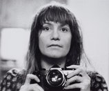 An image of Self-portrait with camera (1960-2006) by Sue Ford