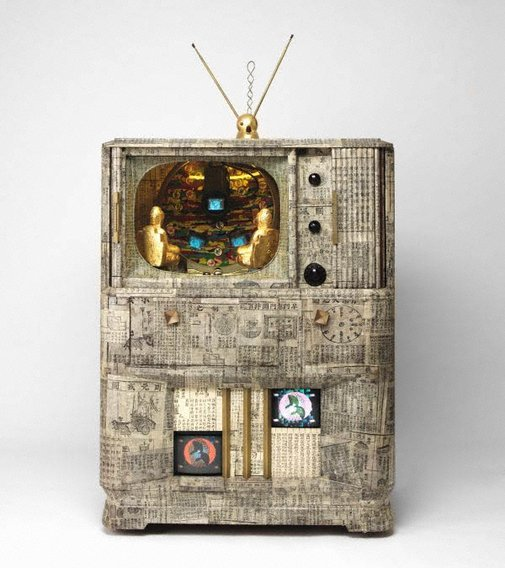 An image of Buddha game by Nam June Paik