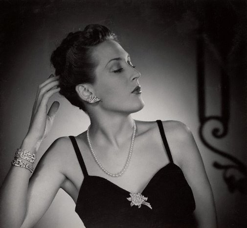 An image of Untitled (woman with diamante earrings) by Max Dupain