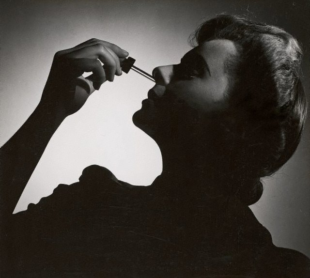 An image of Untitled (woman with nose dropper)