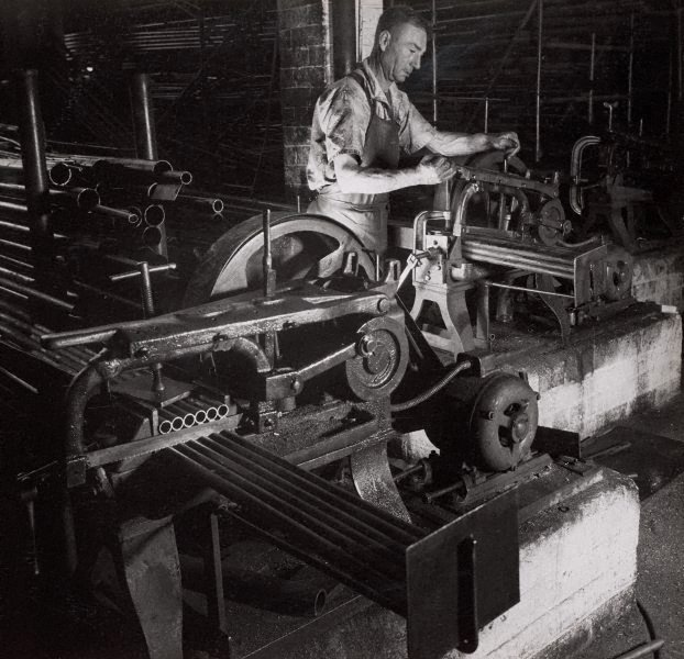 An image of Untitled (man with pipe cutting machine)