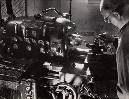 An image of Untitled (man and Holbrook machine) by Max Dupain