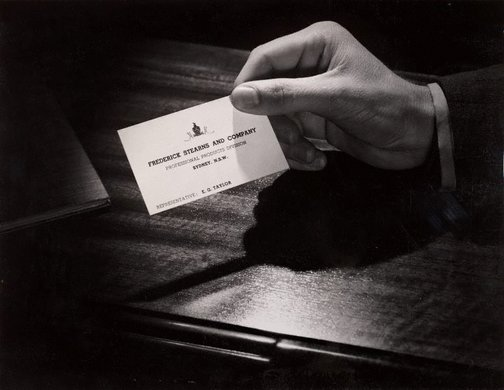 An image of Untitled (hand and business card) by Max Dupain