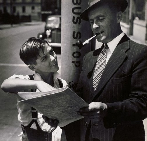 An image of Untitled (newspaper boy at bus stop) by Max Dupain