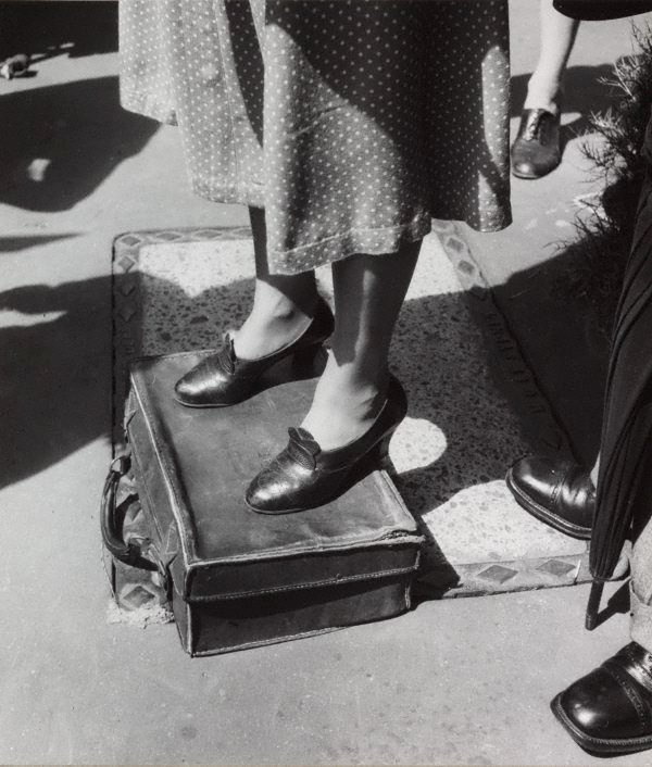 An image of Untitled (standing on a suitcase)