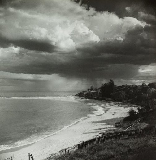 An image of Untitled (beach with thunderstorm) by Max Dupain
