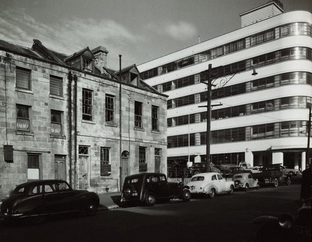An image of Untitled (parked cars and terraces)