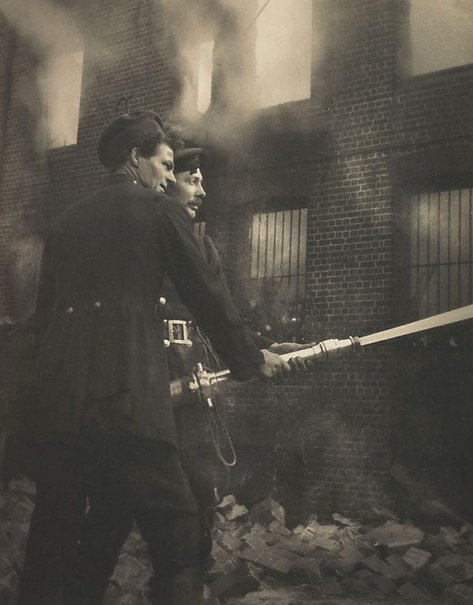 An image of Boys with hose, fire at Redfern by Harold Cazneaux