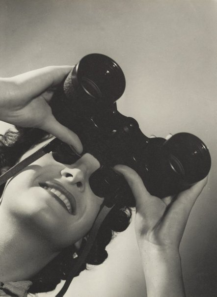 An image of Untitled (woman with binoculars) by Max Dupain