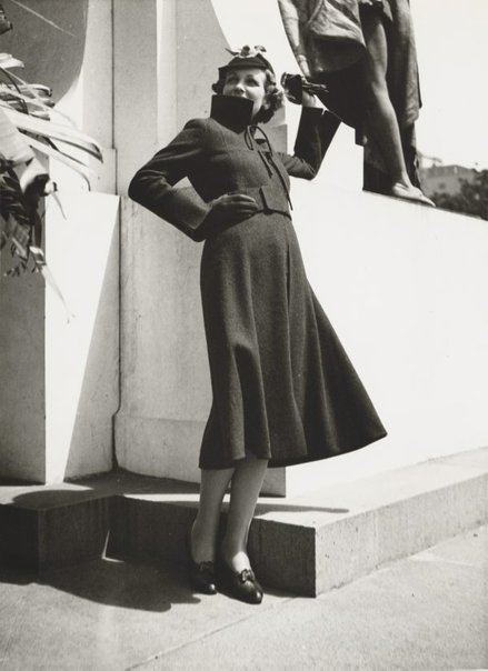 An image of Untitled (fashion illustration: model standing beside the Shakespeare Memorial) by Max Dupain