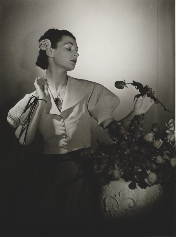 An image of Untitled (fashion illustration: model with bouquet of roses)