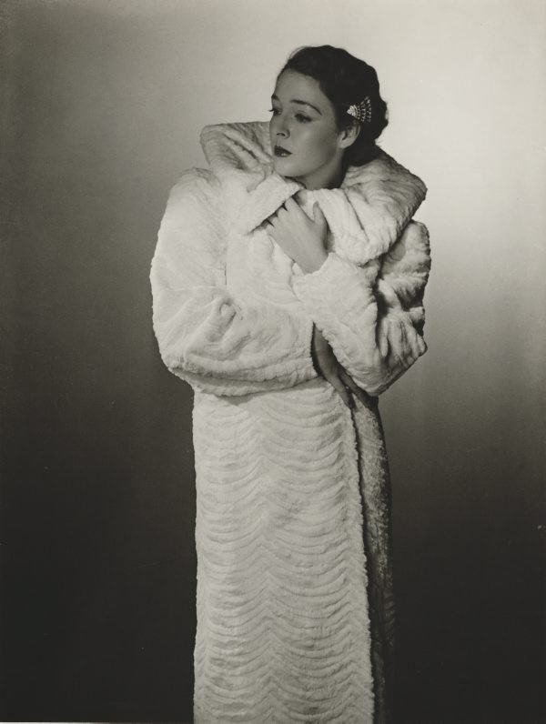 An image of Untitled (fashion illustration: model in a white coat)