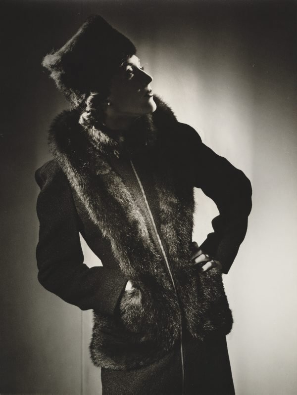 An image of Untitled (fashion illustration: model in a dark hat and fur coat)