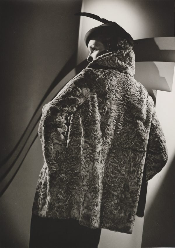 An image of Untitled (fashion illustration: model in a large fur coat)