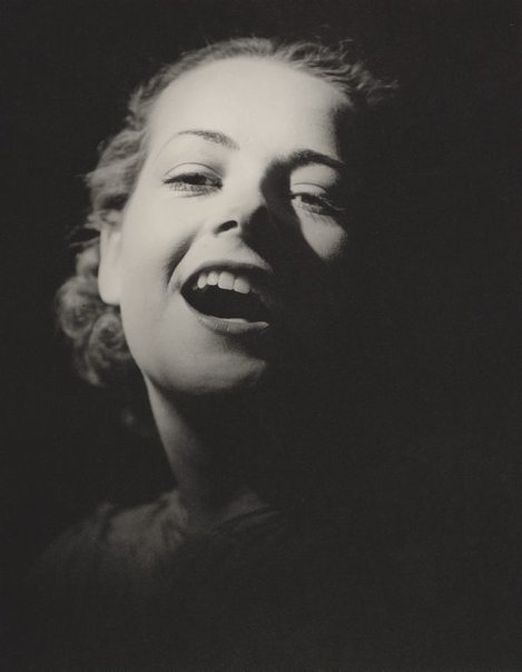 An image of Untitled (smiling woman) by Max Dupain