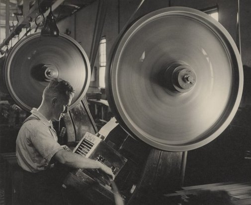 An image of Untitled (man working machine) by Max Dupain