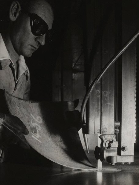 An image of Untitled (working using metal saw) by Max Dupain