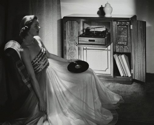 An image of Untitled (woman listening to record player) by Max Dupain