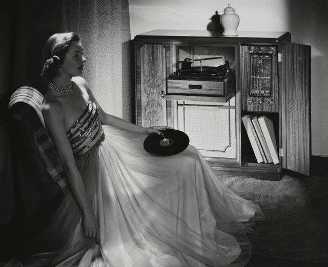 An image of Untitled (woman listening to record player)