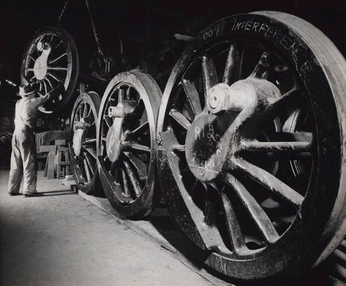 An image of Untitled (metal wheels in factory) by Max Dupain