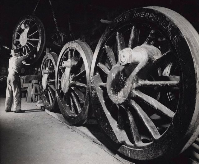 An image of Untitled (metal wheels in factory)