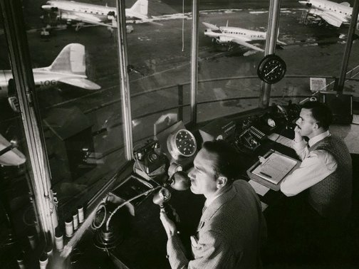 An image of Untitled (air traffic controllers, Kingsford Smith) by Max Dupain