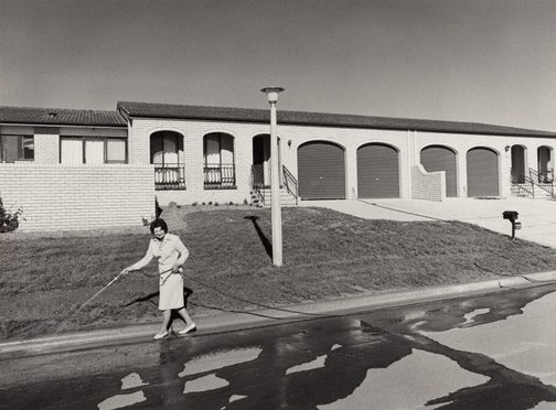 An image of Woman hosing, Canberra by Gerrit Fokkema