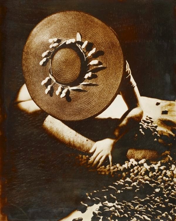 An image of recto: Untitled (woman in hat with peanuts) verso: Untitled (Robinson Crusoe: man on beach in 'cave man' furs)
