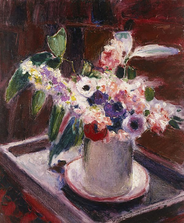 An image of Anemones and stock in white jug