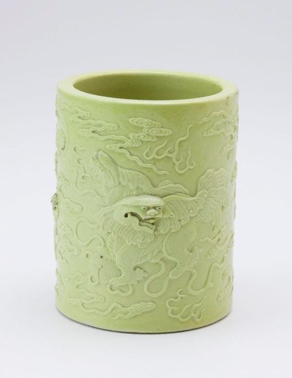 An image of Brush pot decorated with male Buddhist lion, two puppies and a bat