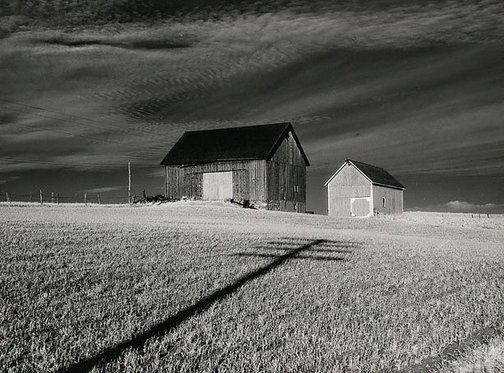 An image of Two barns and cross, vicinity of Dansville, New York by Minor White