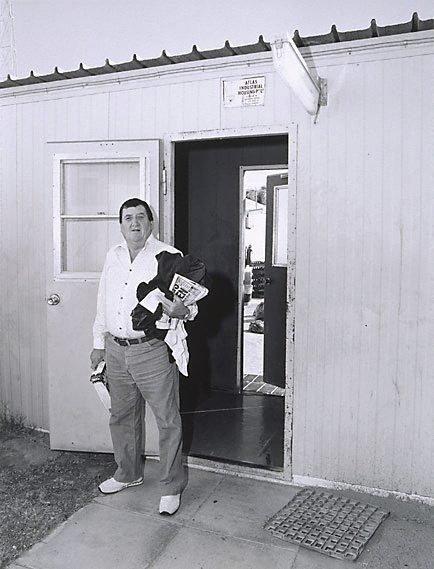 An image of 'Choo Choo' Don Lloyd about to do his washing, Mt Gunson single men's quarters