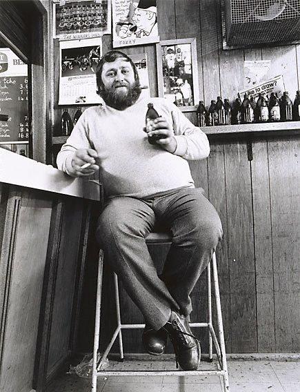 An image of 'Top Cat' Graeme McClaren in his corner at the bar, single men's quarters, Mt Gunson