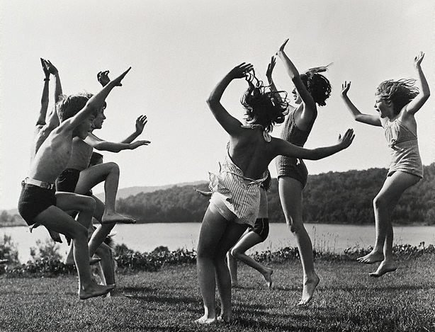 An image of Children dancing by the lake