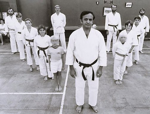 An image of Ali Kahn and his Tae Kwondo class, Mt Gunson town centre by Gerrit Fokkema