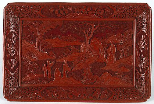 An image of Rectangular tray on four feet, carved with scene depicting scholars in learned discussion in a landscape by