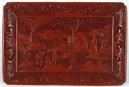 An image of Rectangular tray on four feet, carved with scene depicting scholars in learned discussion in a landscape