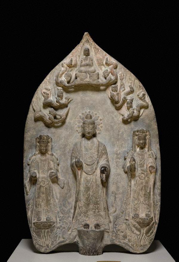 An image of Votive stele of Shakyamuni Buddha flanked by two bodhisattvas