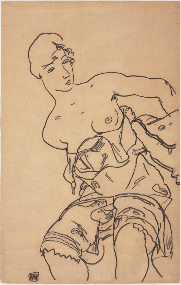 An image of Seated woman with bare breasts