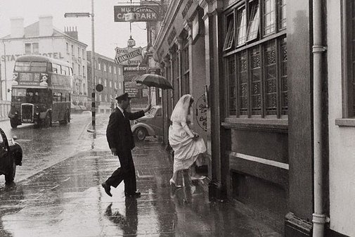 An image of Bride in the rain, Hammersmith, London by Lewis Morley