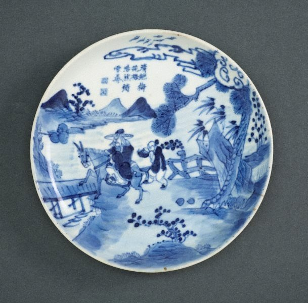 An image of Plate with man and attendant in a landscape setting