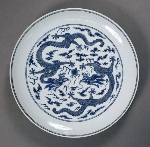 An image of Plate with dragon playing with a flaming pearl by Jingdezhen ware
