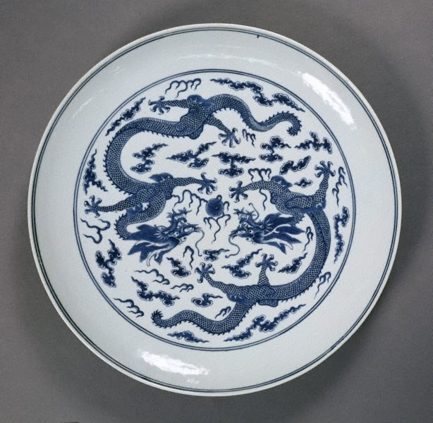 An image of Plate with dragon playing with a flaming pearl