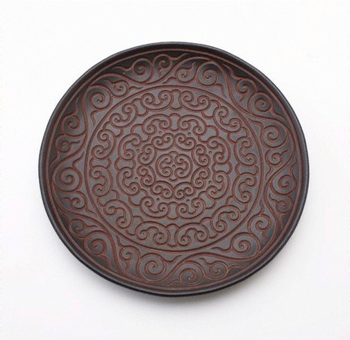 An image of Plate decorated with floral motifs by