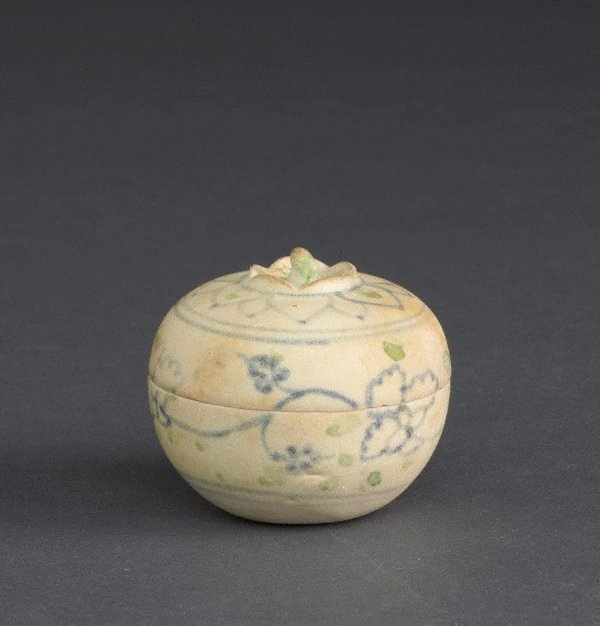 An image of Covered box with floral decoration and green spots