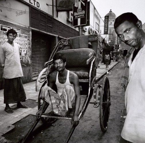 An image of Rickshaw puller – Calcutta by Max Pam