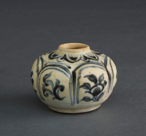An image of Jarlet with a carved shape and floral motifs by