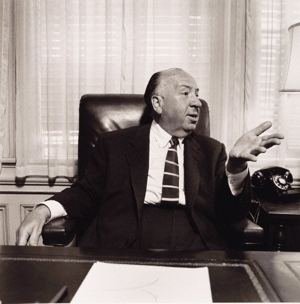 An image of Director, Alfred Hitchcock in his office at Universal Studios