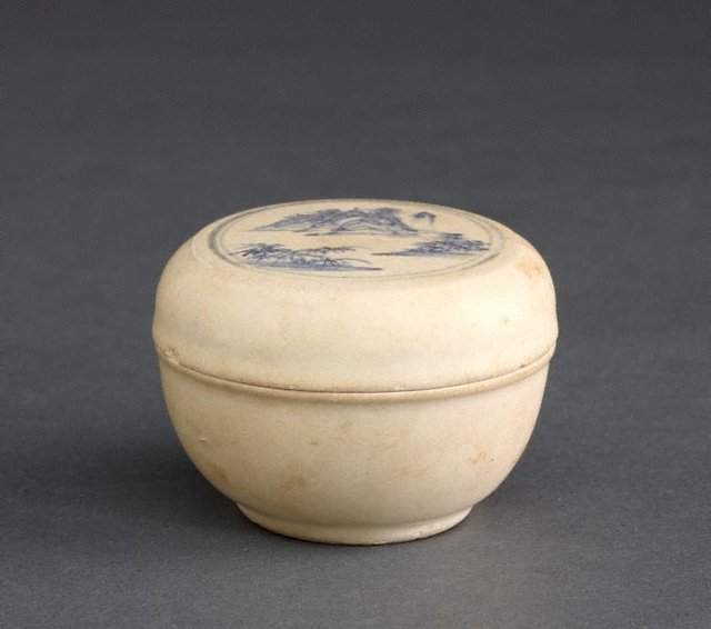 An image of Covered box with a landscape scene on the lid
